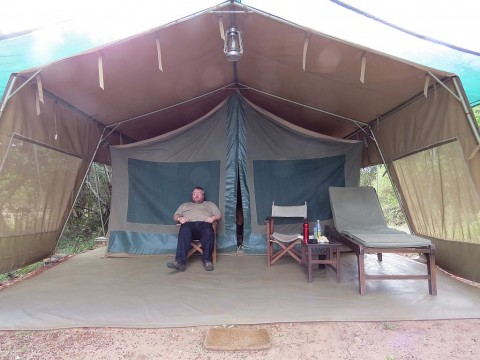 andy-outside-tent-masai-mara-national-reserve1