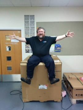 Andy sits on the Eaton UPS!